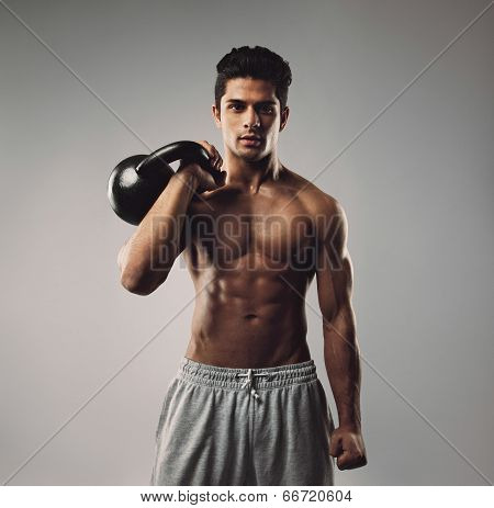 Strong Young Man Working Out With Kettle Bell