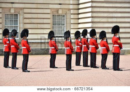 LONDON, UK a?? JUNE 12, 2014: British Royal guards perform the Changing of the Guard in Buckingham Palace