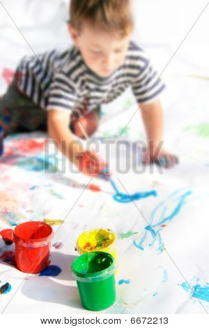 Young Boy Painting, Focus On Cans