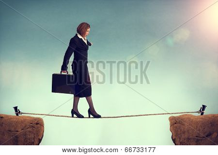 Businesswoman Balancing On A Tightrope