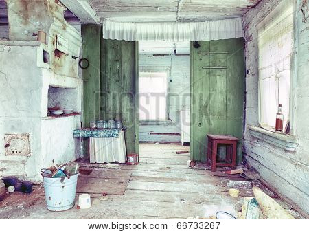 Old small abandoned and ruinous country house interior  in Russia