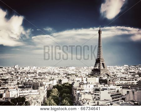 Rooftop view on the Eiffel Tower from Arc de Triomphe. Sunny day, blue sky. Tour Eiffel