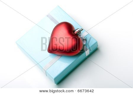 Elegant beautiful glossy blue jewelry gift box with ribbon and red valentine day heart present isola