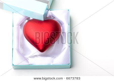 Red heart ornament decoration love symbol gift in a jewelry box for Valentine Day celebration presen