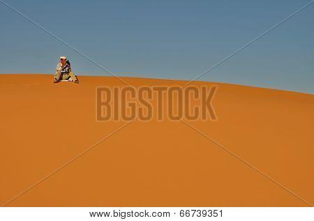 Merzouga Desert - October 01: Man In Traditional Berber Wear Taking Photograph In Merzouga Desert, M