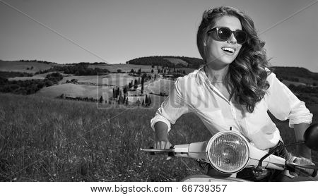Young and sexy woman with her motor scooter. BW photo