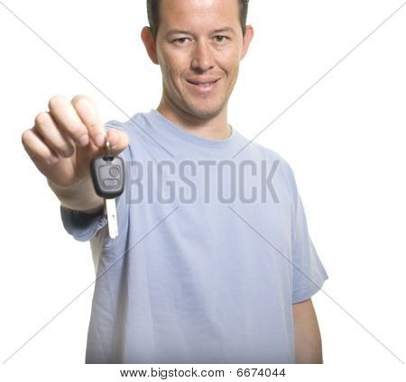 Young Man Holding Out Car Key