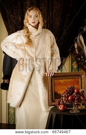 Fashion shot of a beautiful lady in a luxurious fur clothing. Vintage style.