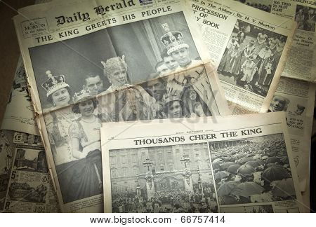 LONDON, UK - JUNE 16, 2014: King cheering his peopel, Royal family on front of Vintage English newsp