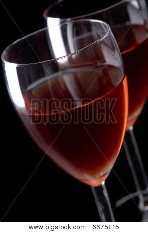 Two elegant glasses filled with red wine