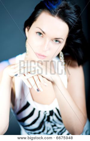 excellent manicure of young caucasian girl dark hair isolated