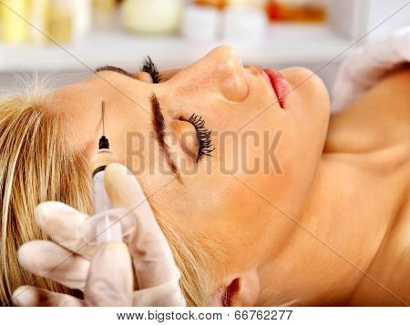 Beauty woman giving injections.