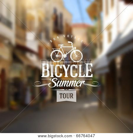 Type vintage design with bicycle silhouette against a old european street defocused background