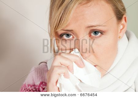 Woman having a cold or flu