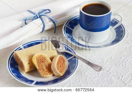 Bolo De Rolo (swiss Roll, Roll Cake) Typical Brazilian Dessert Blue Cup Of Coffee