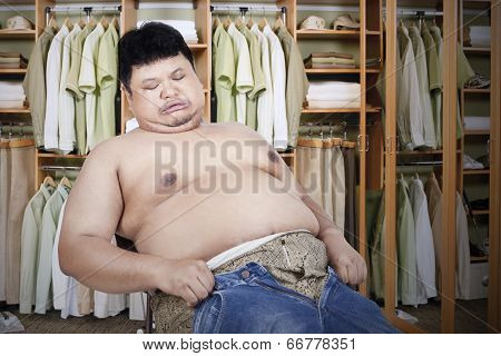 Fat Man With His Old Jeans
