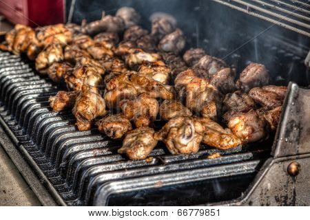 Barbecued Chicken Wings On An Outdoor Grill