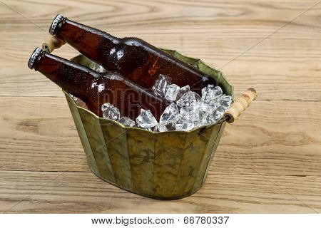 Cold Beer Bottles In Metal Bucket Filled With Ice