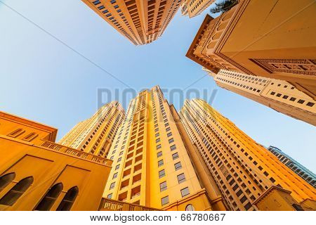 DUBAI, UAE - MARCH 30: Skyscrapers of Dubai Marina on March 30, 2014, UAE. Dubai Marina is a district in Dubai with artificial canal city who accommodates more than 120,000 people.