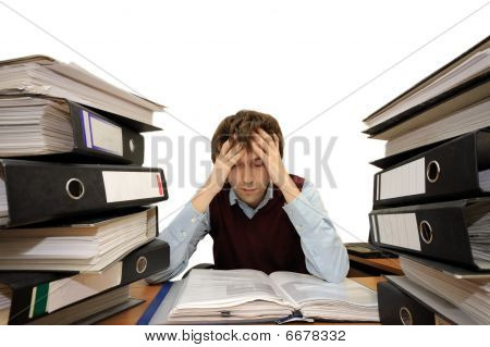 Tired man appears to be overwhelmed by his work