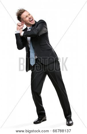 Full-length portrait of businessman shoving something who wears suit with blue tie, isolated