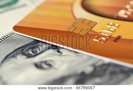 Close-up credit card on 100 dollars note with shallow depth of field