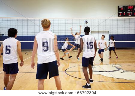 High School Volleyball Match In Gymnasium