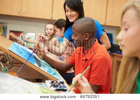 Male Pupil In High School Art Class With Teacher