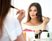 pic of mirror  - Beauty woman applying makeup - JPG