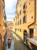 foto of gondolier  - Gondola with gondolier in Venice channel - JPG