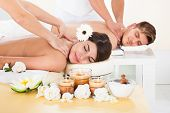 pic of acupressure  - Portrait of smiling young couple receiving massage at spa - JPG