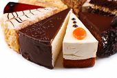 pic of sponge-cake  - Assortment of pieces of cake - JPG