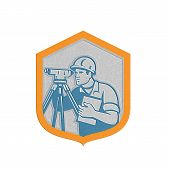 picture of theodolite  - Metallic styled illustration of a surveyor geodetic engineer with theodolite instrument surveying viewed from side set inside shield crest done in retro style on isolated white background - JPG