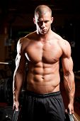 stock photo of half-naked  - Portrait of an attractive athletic young man in a gym - JPG