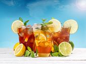 pic of iced-tea  - Fresh and cold ice tea with sliced lemon and mint - JPG