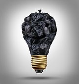 stock photo of waste disposal  - Garbage management solutions concept with a group of black trash bags shaped as a light bulb as a symbol and icon of environmental damage and recycling waste issues - JPG