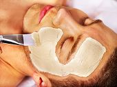 stock photo of facials  - Man with clay facial mask in beauty spa - JPG