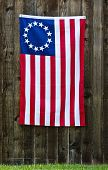 picture of betsy ross  - 13 Star American flag the Betsy Ross flag displayed on rustic wooden fence - JPG