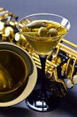 image of saxophones  - saxophone and martini with green olives focus on foreground - JPG