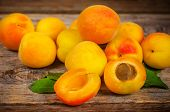 picture of strawberry plant  - apricots on a dark wood background - JPG