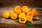 stock photo of apricot  - apricots on a dark wood background - JPG