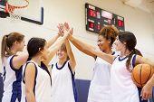 stock photo of motivation talk  - Female High School Basketball Team Having Team Talk - JPG