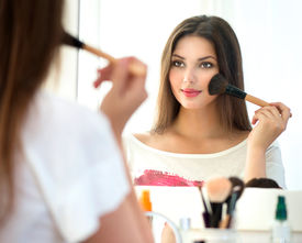stock photo of face-powder  - Beauty woman applying makeup - JPG