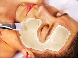 foto of beauty parlour  - Man with clay facial mask in beauty spa - JPG
