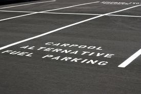 stock photo of fuel economy  - Carpool Alternative Fuel Parking space on new parking lot - JPG