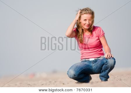 Young Woman On Sea Shore
