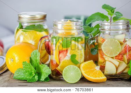Mug Delicious Refreshing Drink Of Mix Fruits With Mint On Wooden, Infused Water