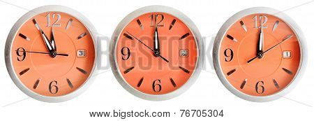 Set Of Orange Clock Faces With Midnight Time