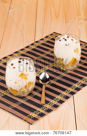Cream of fruits decorated with chocolate beads