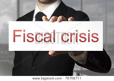 Businessman Holding Sign Fiscal Crisis